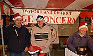 3 people behind stall at Age Concern Christmas Fayre