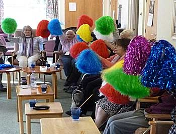 Members with pom-poms