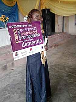 Nigerian girl holding denmentia banner